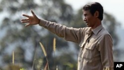 Chut Wutty, former Director of the Natural Resource Protection Group, gestures at Botum Sakor National Park in Koh Kong province, Cambodia, file photo.)