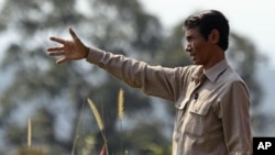 Chut Wutty, Director of the Natural Resource Protection Group, gestures at Botum Sakor National Park in Koh Kong province, Cambodia, February 2012. (file photo)
