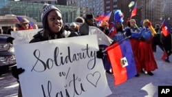 FILE - Haitian activists and immigrants protest on City Hall Plaza in Boston, Jan. 26, 2018.