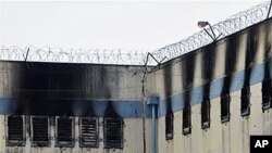 An area of the San Miguel prison is burned after a fire killed at least 83 prisoners in Santiago, Chile, 08 Dec. 2010