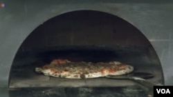 Nagrade i medalje Hakkiju zbog tehnike pravljenja pizze
