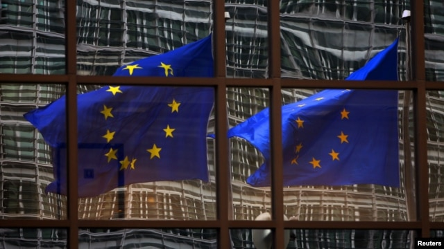 FILE - European Union flags at the EU headquarters in Brussels.