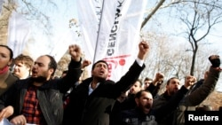 Protesters oppose the Turkish Parliament's approval of a law blocking some Internet access.