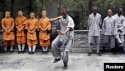 An African student (C) practices martial art at the Shaolin Temple in Dengfeng, Henan province, China, Sept. 25, 2013.