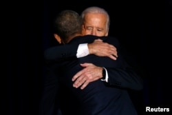 FILE - U.S. President Barack Obama is joined onstage by Vice President Joe Biden after his farewell address in Chicago, Jan. 10, 2017.