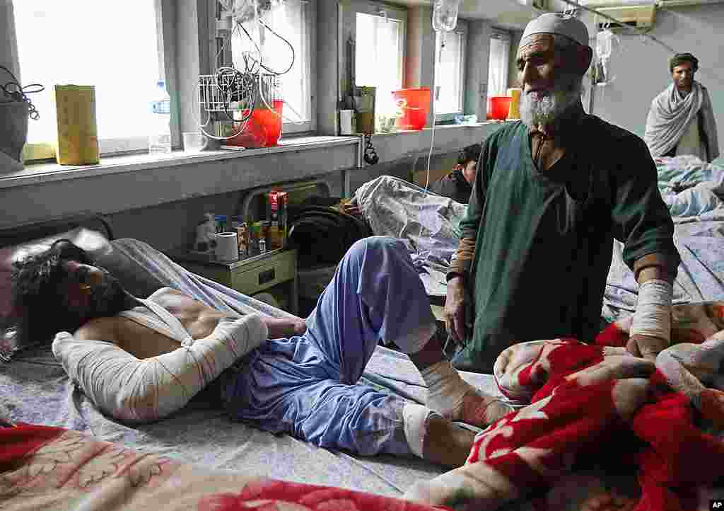 An Afghan man receives treatment at a hospital in Jalalabad province after a suicide car bomber attacked a military airport on February 27, 2012. (Reuters)
