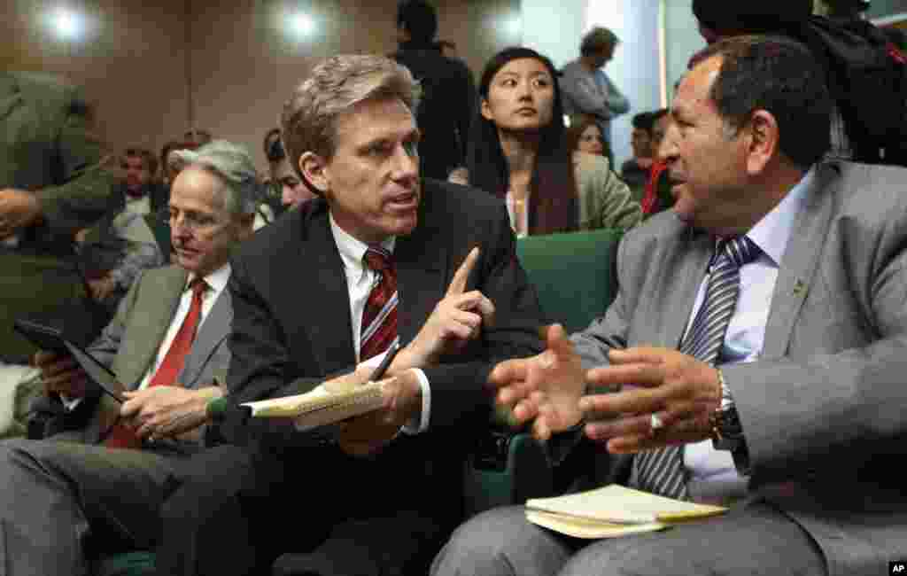 U.S. envoy Chris Stevens, center, accompanied by British envoy Christopher Prentice, left, speaks to Council member for Misrata Dr. Suleiman Fortia, right, at the Tibesty Hotel where an African Union delegation was meeting with opposition leaders in Benghazi.