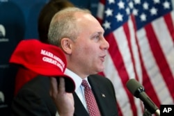 """House Majority Whip Steve Scalise of Louisiana displays a """"Make America Great Again"""" hat while speaking with reporters on Capitol Hill in Washington after a House Republican leadership meeting, Nov. 15, 2016."""
