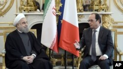 Iranian President Hassan Rouhani, left, visits French President Francois Hollande at the Elysee Palace in Paris, Jan. 28, 2016.