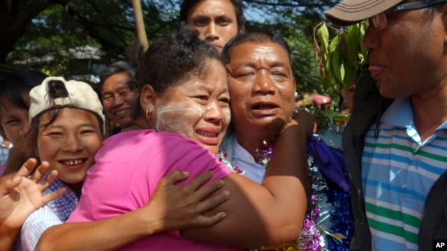 Political prisoner Win Shwe, center, is welcomed by family members after he was released from Insein Prison in Rangoon, Burma, Dec. 31, 2013
