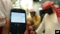 A BlackBerry user in Dubai, United Arab Emirates, displays a text message sent by his service provider notifying him of 11 Oct, 2010 suspension of services, 05 Aug 2010