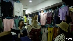 Soung Pisey at here clothes store in Takmao market, Kandal province, Cambodia, October 2017. (Khan Sokumnono/VOA Khmer)