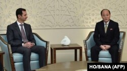 A handout picture shows Syrian President Bashar al-Assad, left, meeting with Vice Minister of Foreign Affairs of the Democratic People's Republic of Korea (DPRK) Sin Hong Chol in Damascus, March 8, 2015.