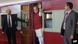 Indian Prime Minister Narendra Modi waves from a train carriage at Pentrich Railway station in Pietermaritzburg, South Africa, July 9, 2016. Modi took the same trip that Mahatma Gandhi took in 1893 when he was thrown off the train because of his race.