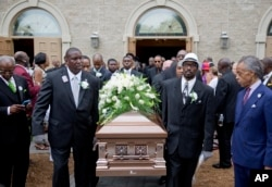 The Rev. Al Sharpton (R) watches as the casket of Ethel Lance is carried to a hearse following her funeral service, June 25, 2015, in North Charleston, S.C.