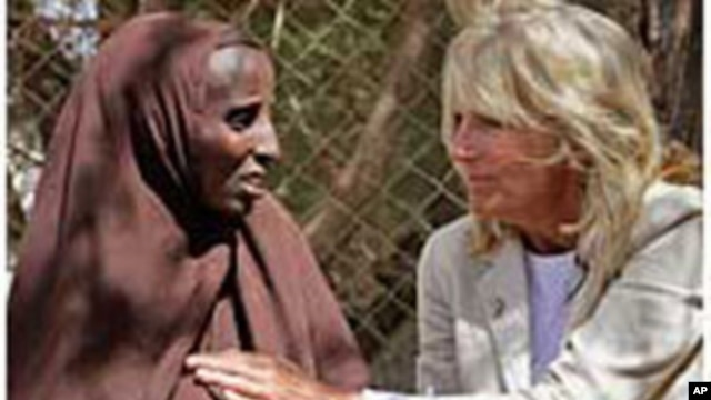 Jill Biden, wife of U.S. Vice President Joe Biden, center, sits with Somali refugees at a UNHCR screening center on the outskirts of Ifo camp outside Dadaab, eastern Kenya, 100 kms (60 miles) from the Somali border, Aug. 8, 2011.