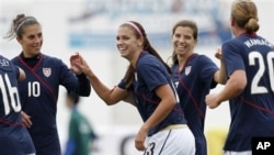 US players Carli Lloyd, Alex Morgan, Tobin Heath and Abby Wambach, from left, react after Morgan scored her second goal against Finland during their women's soccer Algarve Cup match, March 7 2011, in Quarteira, Portugal.