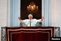 Pope Benedict waves to the faithful from the balcony of his summer residence in Castel Gandolfo, Feb. 28, 2013.