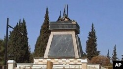An empty plinth at the site where the statue of late Syria President Hafez al-Assad was torn down and burnt during protests in Deraa (File)