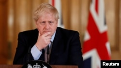 FILE: Britain's Prime Minister Boris Johnson speaks during a news conference on the novel coronavirus, in London, Britain March 3, 2020.
