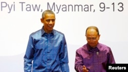 缅甸总统吴登盛在首都内比都欢迎美国总统奥巴马出席东盟第25届峰会。