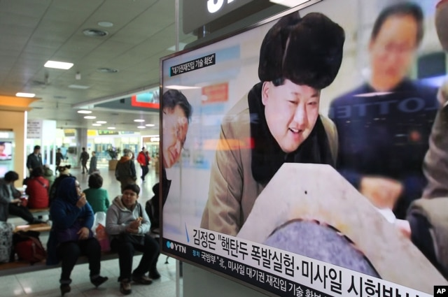A TV screen shows North Korean leader Kim Jong Un during a news program at Seoul Railway Station in Seoul, South Korea, March 15, 2016 — the same day state media said Kim had warned of impending tests of a nuclear warhead and ballistic missiles.