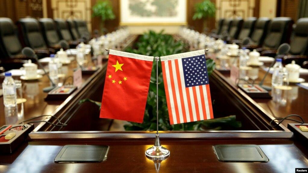 美國農業部長桑尼·珀杜和中國農業部長韓長賦2017年6月30日在中國農業部開會前的會議室(路透社資料照)