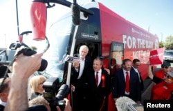 Jeremy Corbyn, the leader of Britain's opposition Labour Party, boards his battle bus as he campaigns in Whythenshawe, May 9, 2017.