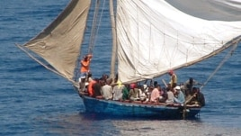 FILE - A boat overcrowded with Haitian migrants is seen off the coast of Florida.