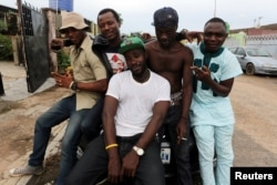 Members of the Fire Nation Blowing Purple Cloud hip hop crew pose for a picture outside recording studio in the Festac district of Lagos, Nigeria, May 17, 2016.