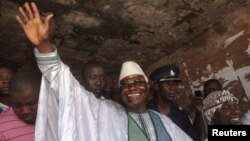Sierra Leone's president Ernest Bai Koroma waves to supporters after voting in the capital Freetown, November 17, 2012.
