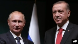FILE - Russian President Vladimir Putin, left, and his Turkish counterpart, Recep Tayyip Erdogan, wrap up a joint news conference at the Presidential Palace in Ankara, Turkey, Dec. 1, 2014, when they enjoyed more cordial relations.