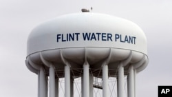 FILE - The Flint, Michigan,water tower is seen Feb. 5, 2016.