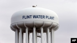 FILE - The Flint, Michigan, water tower is seen in a Feb. 5, 2016, photo. Flint is under a public health emergency after its drinking water became tainted when the city switched from the Detroit system and began drawing from the Flint River in 2014 to save money.