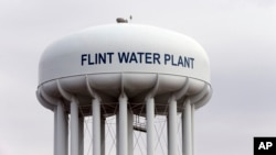 The Flint, Mich., water tower is seen in this Feb. 5, 2016 photo. Flint's drinking water became tainted when the city switched from the Detroit system and began drawing from the Flint River in 2014 to save money.