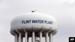 FILE - The Flint, Mich.,water tower is seen in this Feb. 5, 2016 photo. Nearly 100,000 people were affected by the contaminated water and U.S. federal health officials found that young children in Flint had significantly higher levels of dangerous lead in their blood.