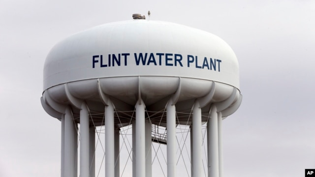 The Flint, Mich.,water tower is seen in this Feb. 5, 2016 photo.  Flint is under a public health emergency after its drinking water became tainted when the city switched from the Detroit system and began drawing from the Flint River in 2014 to save money.