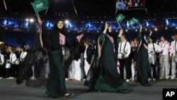 Saudi Arabia's Wojdan Ali Seraj Abdulrahim Shaherkani, center, opening ceremony of the 2012 Summer Olympics, London, July 27, 2012.