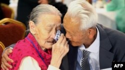 FILE - South Korean Kwon O-Hui (L) cries with her North Korean relative Ri Han-Sik (R) as they bid farewell following their three-day family reunion meeting at the Mount Kumgang resort on the North's southeastern coast, Oct. 22, 2015.