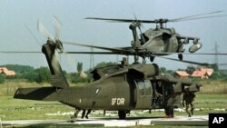 FILE - Two US UH-60 Black Hawk helicopters take off from a camp in Bosnia-Herzogovina in this Aug. 28, 1997 photo.