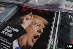 FILE - A magazine featuring U.S. President-elect Donald Trump is seen at a bookstore in Beijing, Dec. 12, 2016.