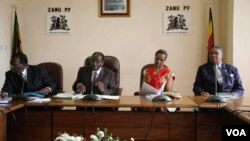 First Lady Grace Mugabe sits with the presidium at a Zanu PF meeting.