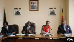 Grace Mugabe sits with the presidium at a Zanu PF meeting.