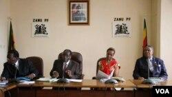 Grace Mugabe sits with the presidium at a Zanu PF meeting.