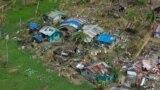 A devastated village in Eastern Samar province makes a plea for help, Philippines, Nov. 19, 2013. (Steve Herman/VOA)