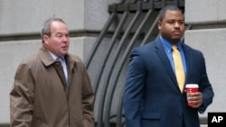 FILE - William Porter, right, one of six Baltimore city police officers charged in connection to the death of Freddie Gray, walks into a courthouse with his attorney Joseph Murtha for jury selection in his trial, in Baltimore, Nov. 30, 2015.