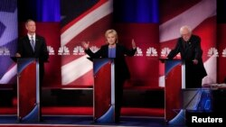 FILE - From left, Democratic U.S. presidential candidates former Maryland Gov. Martin O'Malley, former Secretary of State Hillary Clinton and Senator Bernie Sanders of Vermont participate in a debate in Charleston, S.C., Jan. 17, 2016.