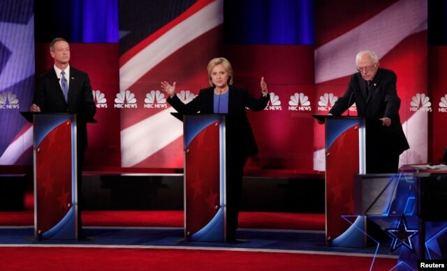 From left, Democratic U.S. presidential candidates former Maryland Gov. Martin O'Malley, former Secretary of State Hillary Clinton and Senator Bernie Sanders of Vermont participate in a debate in Charleston, S.C., Jan. 17, 2016.