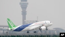 FILE - A Chinese-made C919 passenger jet takes off on its maiden test flight at Pudong International Airport in Shanghai, May 5, 2017.