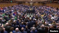 Tellers announce the results of the vote on Brexit in Parliament in London, Britain, March 13, 2019, in this image taken from video.